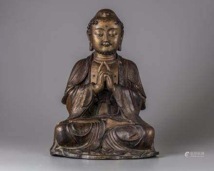 A Chinese parcel-gilt bronze figure of a monk