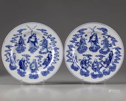 A pair of Chinese blue and white 'Eight Immortals' dishes