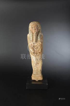 Statuette représentant Ptah-Sokar-Osiris momiforme portant une longue perruque tripartite ai