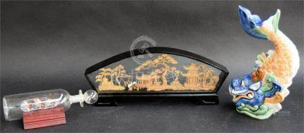A Chinese cork picture in glass case, with buildings and the 'lucky emblems' of storks and pine