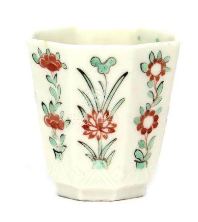 A London-decorated Chinese blanc de Chine beaker Kangxi 1662-1722, the flared octagonal form painted