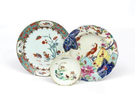 Two Chinese porcelain plates and a saucer 18th/early 19th century, one decorated in famille verte