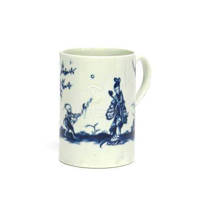 A Worcester blue and white mug c.1765, painted with the Walk in the Garden pattern, a Chinese boy