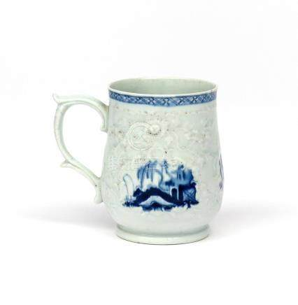 A Philip Christian (Liverpool) blue and white mug c.1765-72, finely moulded with flowering