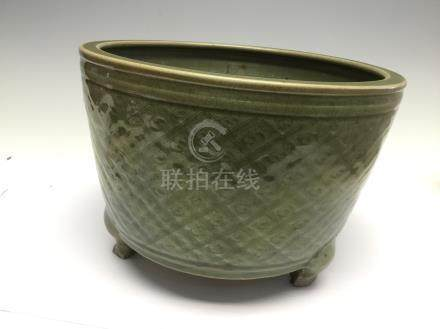 A Chinese celadon tripod censer, with incised diaper design, Ming Dynasty, 14th Century (riveted),