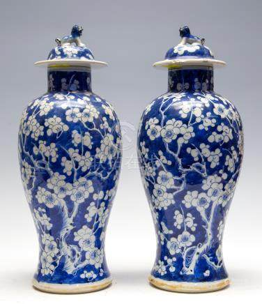 A pair of Chinese blue and white baluster vases and covers, late 19th Century with Kangxi marks,
