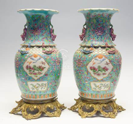 A pair of Chinese famille rose vases, mid 19th Century, turquoise ground, raised on ormolu mounts,