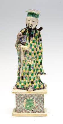 A Chinese glazed biscuit figure of an immortal, 19th Century,