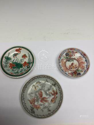 A Chinese famille verte saucer, together with an unusual glass saucer,