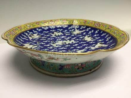 A famille rose footed dish, mid 19th Century, with cranes on a blue ground,