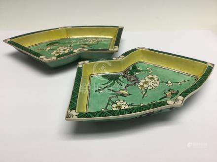 A pair of biscuit glazed fan shaped dishes, 18th Century,