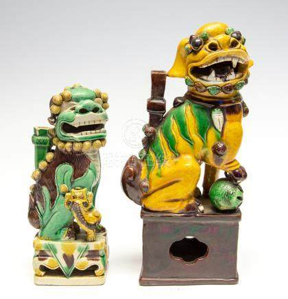 A biscuit glazed dog of fo, 18th Century, together with a larger glazed dog of fo, 19th Century,