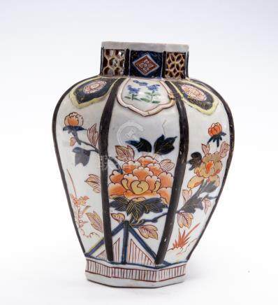 A Japanese imari vase, late 18th Century, of octagonal form, the neck with pierced decoration,