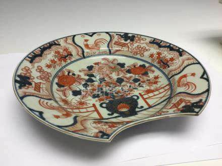A Japanese imari barbers bowl, 18th Century, decorated with a vase of flowers,