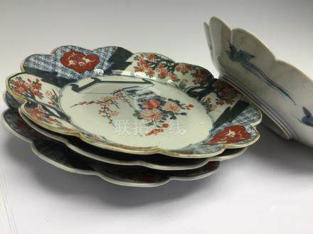 A set of four Japanese imari plates with foliate rims, late 19th Century,