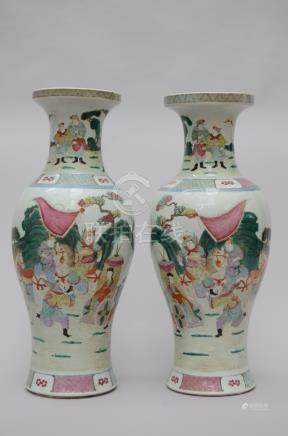 A pair of vases in Chinese famille rose porcelain 'warriors', marked (*)