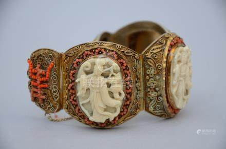 A Chinese silver bracelet with ivory plaques and coral