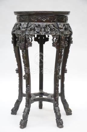 Round Chinese pedestal in hardwood