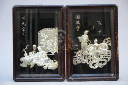 A pair of Chinese bas-reliefs in metal