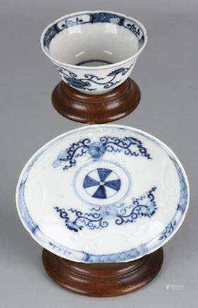 18th Century porcelain cup and saucer with German
