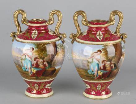 Two antique Viennese vases with gold and figures
