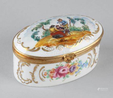 Old Sevres branded porcelain box. Oval with gold decor