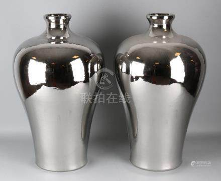 Two large Chinese porcelain vases with silver colored