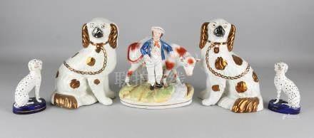 Five antique earthenware glazed statues. England.
