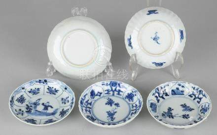 Five 18th century Chinese porcelain dishes with feasts