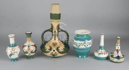 Six times antique Arnhems pottery with floral decor.