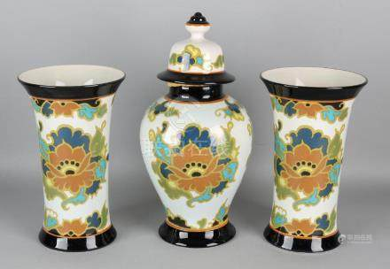 Three-piece Gouda pottery cabinet set. Modica Gouda