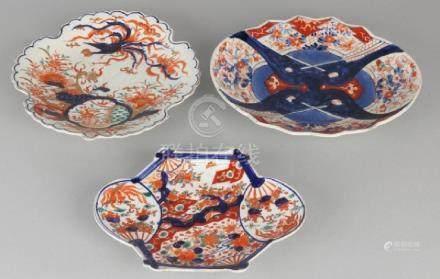 Three pieces of 19th century Imari porcelain dishes.