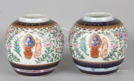 Two Chinese ginger jars with Samson and gold decor.