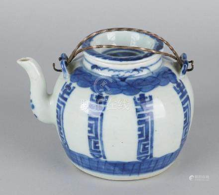 Old Chinese porcelain pot with metal handles and