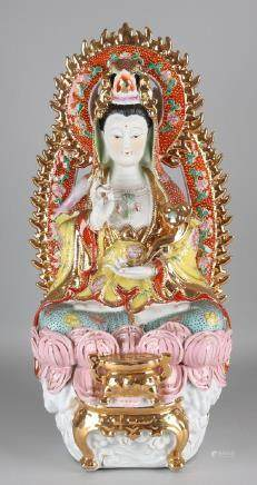 Very large porcelain buddha statue with gilding.