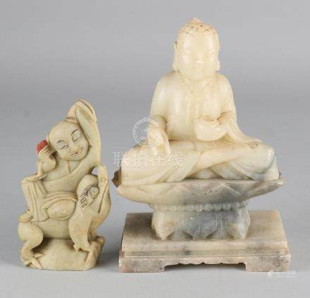 Two antique Chinese Oriental natural stone buddhas.