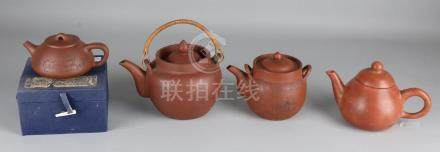 Four ancient Chinese Yixing teapots, various. Size: 11