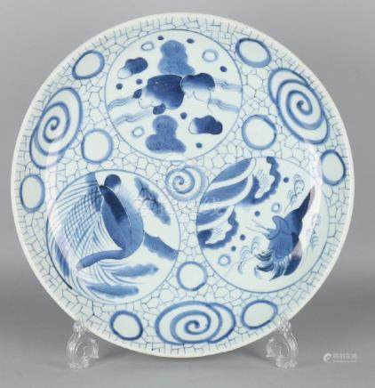 Large old Chinese porcelain dish with animals in