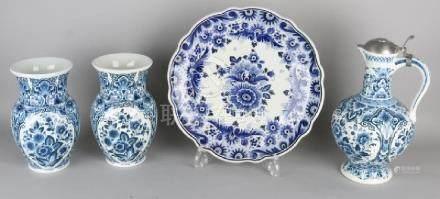 Four parts Dutch Delft blue ceramics. 20th century. One