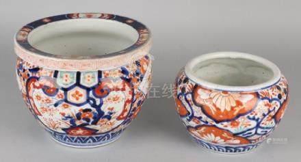 Twice 19th century Japanese Imari porcelain flowerpots
