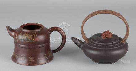 Two old / antique Chinese Yixing teapots. Once antique,