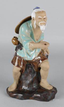 Old Chinese terracotta glazed figure. Chinese man. 20th