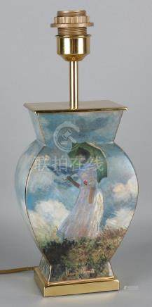 Old brass lamp base with Claude Monet decor. Woman with