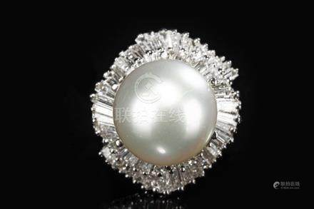 AN AUSTRALIAN SOUTH SEA PEARL AND DIAMOND RING
