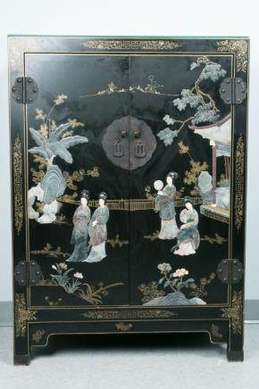 A HARDSTONE-INLAIED BLACK LACQUER CABINET