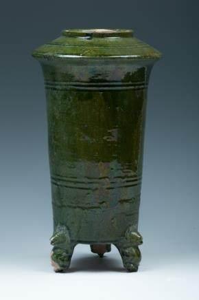 A GREEN GLAZE TRIPOD JAR