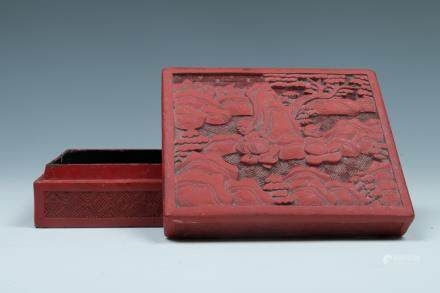 A CINNEBAR LACQUER 'FIGURAL' BOX WITH COVER