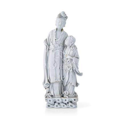 A De Hua figural group of Guanyin and an attendant Qing dyna