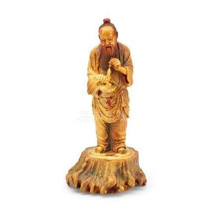 An unusual carved figure of a sage Qing dynasty, 19th centur