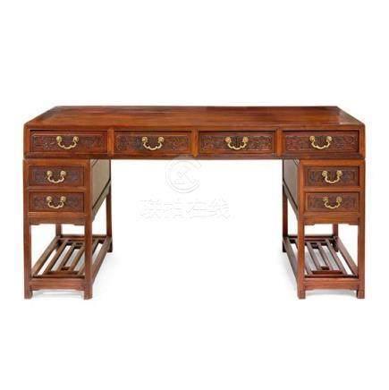 A carved huanghuali and hardwood pedestal desk, 20th century